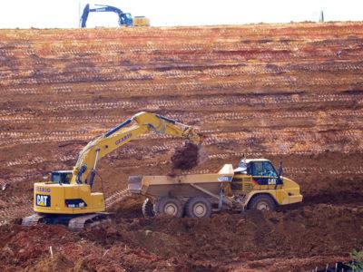 CLR 9 Clear and Grade Excavator Filling Dump Truck 2 w Logo